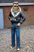 picture of bomber jacket  - A model or statue of an American man wearing a leather bomber jacket and jeans - JPG