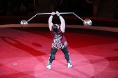Strong Man Showing Tricks With Weights On Arena Of Circus. Tricks On Circus Arena poster