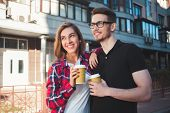 Awesome Couple Walking At Street And Drink A Coffee poster