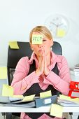 Begging For Help Modern Female Manager Sitting At Workplace Covered With Sticky Notes