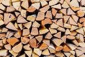 Cut Wooden Logs Texture. Wooden Background. Pieces Of Wood In The Rural Area. Pile Of Cut Wood In Th poster