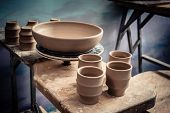 Постер, плакат: Ceramic Clay Products Stand On The Shelf Close up Sculptor Sculpts Pots Products From White Clay W