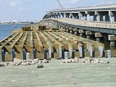foto of rebuilt  - The Caminada Pass fishing bridge in Grand Isle was destroyed by a hurricane - JPG