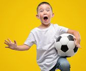 Dark haired little child playing with soccer ball very happy and excited, winner expression celebrat poster