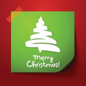 Green paper note with christmas design