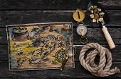 Treasure Map, Shovel Full Of Gold Ore, Compass, Rope And Magnifying Glass On Aged Wooden Table Backg poster