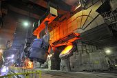 stock photo of blast-furnace  - Pouring of liquid metal shoot inside of plant