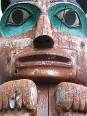 image of tlingit  - Closeup of face on Tlingit Alaska Native totem pole at Wrangell - JPG