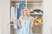 Girl Near The Wardrobe With Clothes Chooses What To Wear Nothing To Wear Concept Design. poster