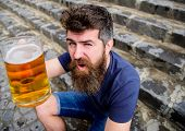 Guy Having Rest With Cold Draught Beer. Hipster On Cheerful Face Drinking Beer Outdoor, Raising Drin poster