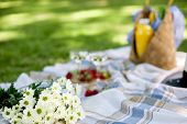 A Bouquet Of Flowers In The Park On A Blanket For A Picnic, Romance In A Summer Sunny Day. Copy Spac poster