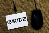 Writing Note Showing Objectives. Business Photo Showcasing Goals Planned To Be Achieved Desired Targ poster