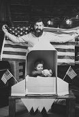 American Dream. American Cheerful Family With Usa Flags Play With Rocket Made Out Of Cardboard Box.  poster
