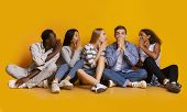 International Group Of Students Gossiping Over Yellow Studio Background, Student Lifestyle poster