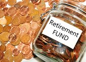 stock photo of coins  - Retirement fund e concept with jar of money and coins - JPG