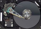Disassemble A Hard Drive From A Computer, A Hard Drive With A Mirror Effect A Hard Drive From A Comp poster