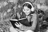 Child Enjoy Reading. Studying Twice Faster Using Visual And Audio Information. Girl Read Book On Aut poster