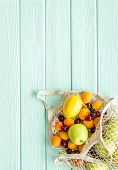 Eco-friendly Package. Eco Bag With Fruits On Green Wooden Background Top-down Copy Space poster