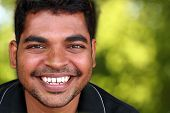Photo Of Happy Lively Handsome Middle-aged Indian/asian Youth Laughing And Having Fun. The Eyebrows