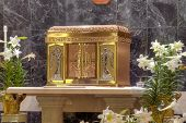 foto of eucharist  - golden Catholic Church Tabernacle surrounded by flowers - JPG