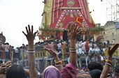 image of jagannath  - devotees praying at car festival of Jagannatha temple at Puri in India - JPG