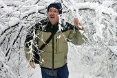 Man Walking Through Snow Filled Branches 2