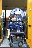 pic of physically handicapped  - Disabled little boy on school bus wheelchair lift - JPG