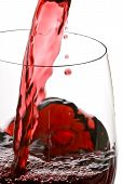 image of red wine  - Red wine is poured into a glass back lit - JPG
