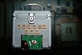 Hard Disk On Black Dark Background With Selective Focus And Iron Safe. Business, Backup March 31st A poster