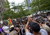 NEW YORK-JULY 11: Occupy Guitarmy protesters end their rally in Zuccotti Park by reciting their beli