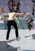 MOSCOW, RUSSIA - JULY 8: Yegor Kaldikov (left) and Semen Kutuzov, Russia, warms up before skateboard competitions during Adrenalin Games in Moscow, Russia on July 8, 2012