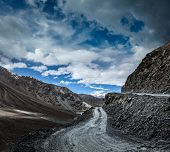 Dirt road in severe unpopulated Himalayas. Spiti valley,  Himachal Pradesh, India