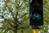Bicycle ecological transport concept background - Bicycle traffic light in Europe. Brugge, Belgium