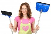 Young housewife with broom and dustpan, isolated on white