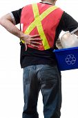 stock photo of pick up  - A city worker suffering from a sore back from picking up blue boxes of recycling - JPG