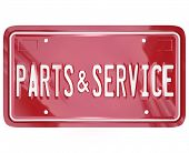 A blue license plate with the words Parts and Service to advertise a collision body shop or garage d