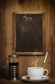 Cup of coffee with menu chalk board