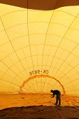 KARLSTEJN, CZECH REPUBLIC - APRIL 14: Baloon inside. Unidentified crew  preparing hot air baloon to fly. Baloon event on April 14, 2013 in Karlstejn, Czech Republic.
