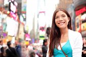 New York City woman as Times Square tourist or young casual woman visiting. Beautiful young happy sm