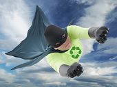 Eco friendly green superhero flying in the air