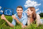 couple searching landscape for new home