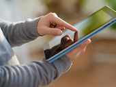 Close-up Of Hand Holding Digital Tablet; Indoors
