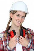 Craftswoman wearing earphones