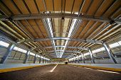 Indoor riding hall with sandy covering.