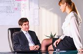 image of office romance  - businesswoman is seducing her boss at office - JPG