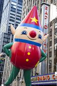 One of Santa's Elves aloft by Radio City Music Hall