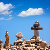 Stone figures on beach shore of Illetes beach in Formentera Mediterranean Balearic Islands