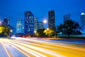 Houston Texas modern skyline at sunset twilight with traffic headlights lights trace