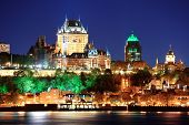 Постер, плакат: Quebec City skyline at dusk over river viewed from Levis