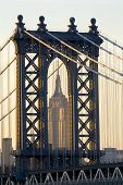 foto of empire state building  - Empire State Building through Manhattan Bridge at Dusk - JPG